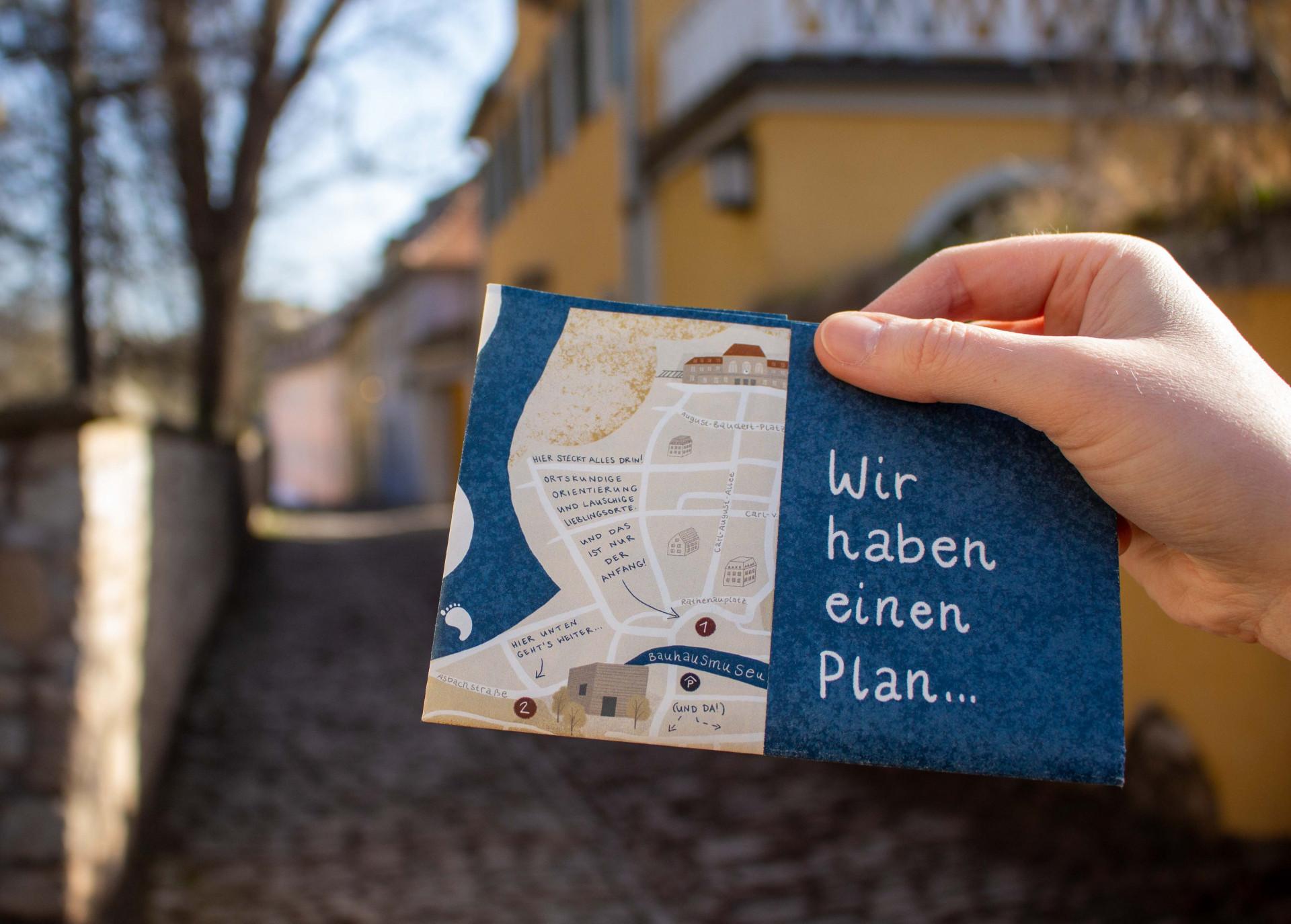 Zusammengefaltete Titelseite des Stadtplans. Darauf der Satz: Wir haben einen Plan.